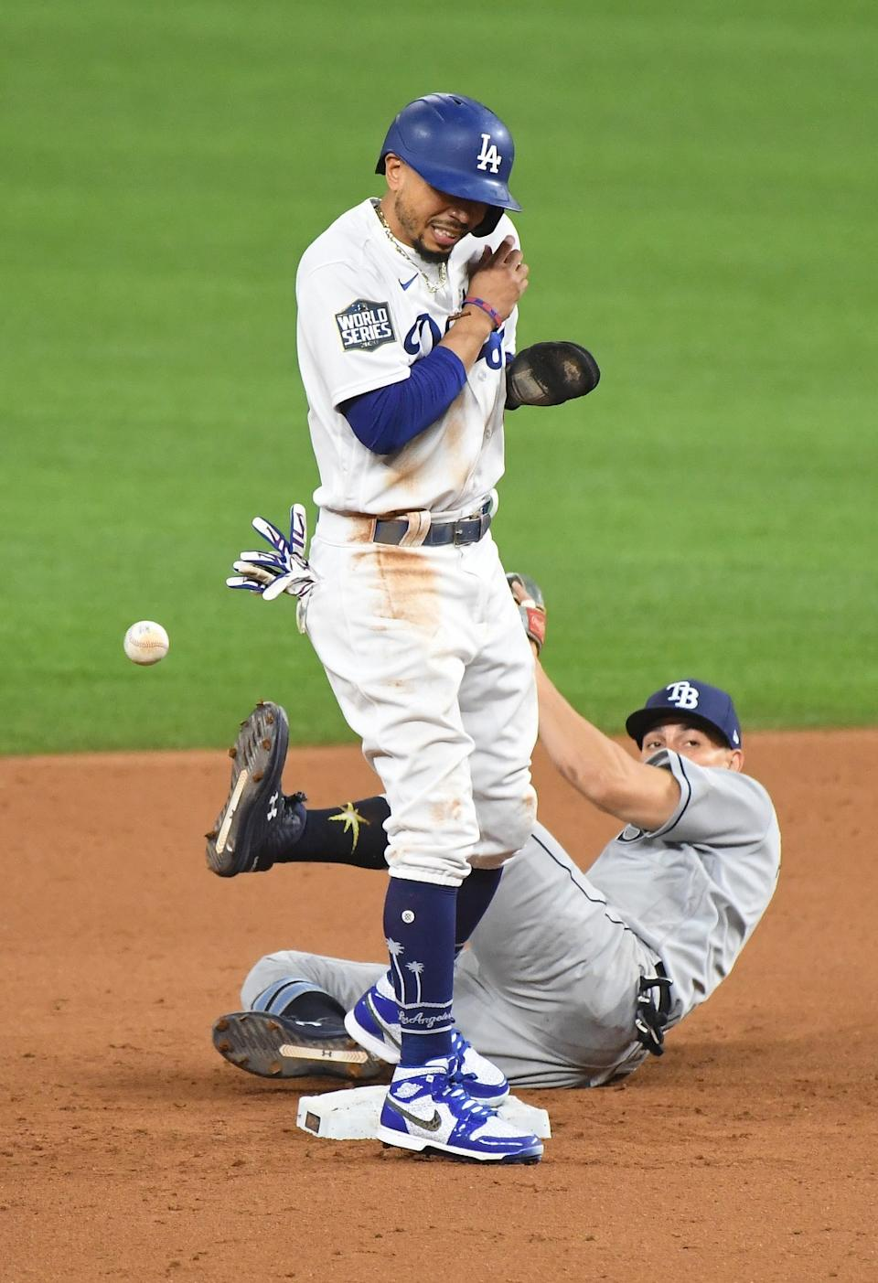 Dodgers baserunner Mookie Betts collides with Tampa Bay Rays shortstop Willy Adames after reaching second base.