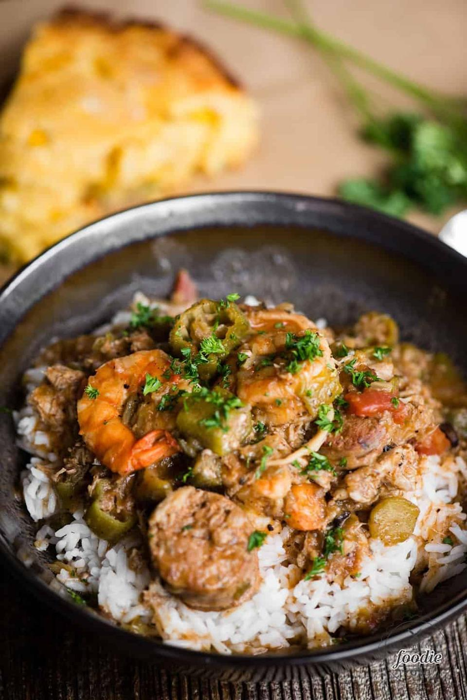 """<p>Get the greatest flavors of gumbo right here when you make this wow-worthy recipe. Shrimp, crab, chicken andouille sausage, and okra work together to make this authentic spicy Cajun meal come to life. Served over rice or grits, this gumbo will transport you to Louisiana in no time.</p> <p><strong>Get the recipe</strong>: <a href=""""https://selfproclaimedfoodie.com/seafood-gumbo/"""" class=""""link rapid-noclick-resp"""" rel=""""nofollow noopener"""" target=""""_blank"""" data-ylk=""""slk:seafood gumbo"""">seafood gumbo</a></p>"""