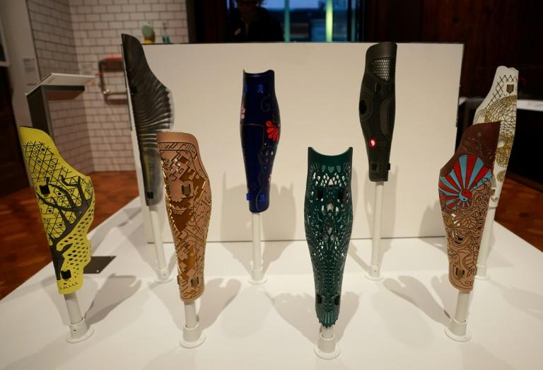 A group of prosthetic leg covers are displayed as part of the Access+Ability exhibit at the Cooper Hewitt Smithsonian Design Museum in New York