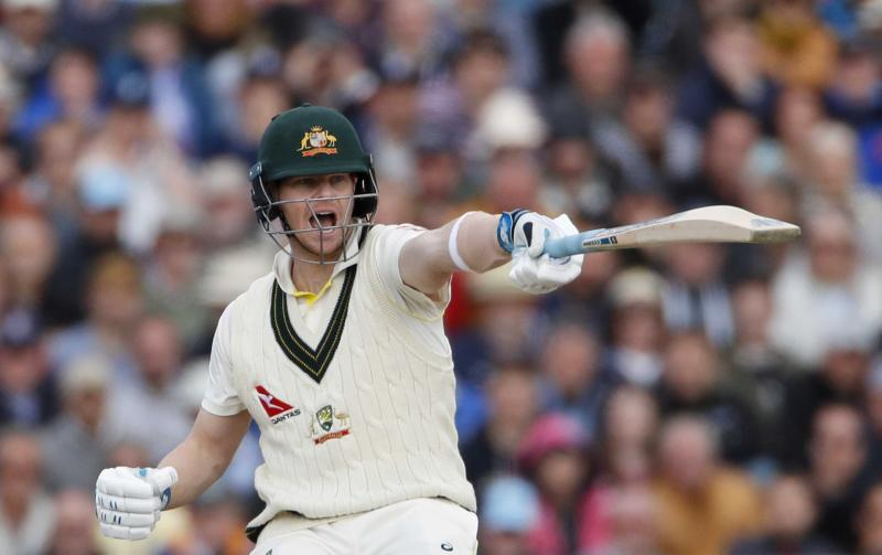 Australia's Steven Smith gestures to teammate Marnus Labuschagne during day one of the fourth Ashes Test cricket match between England and Australia at Old Trafford in Manchester, England, Wednesday, Sept. 4, 2019. (AP Photo/Rui Vieira)