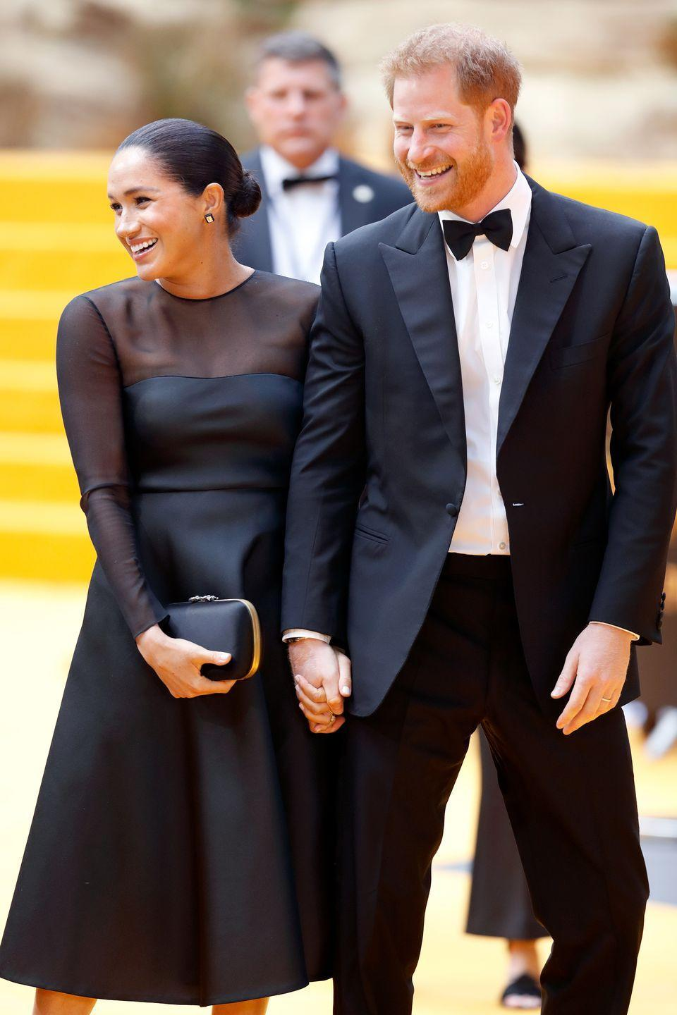 <p>The Duke and Duchess of Sussex laugh heartily during the premiere.</p>