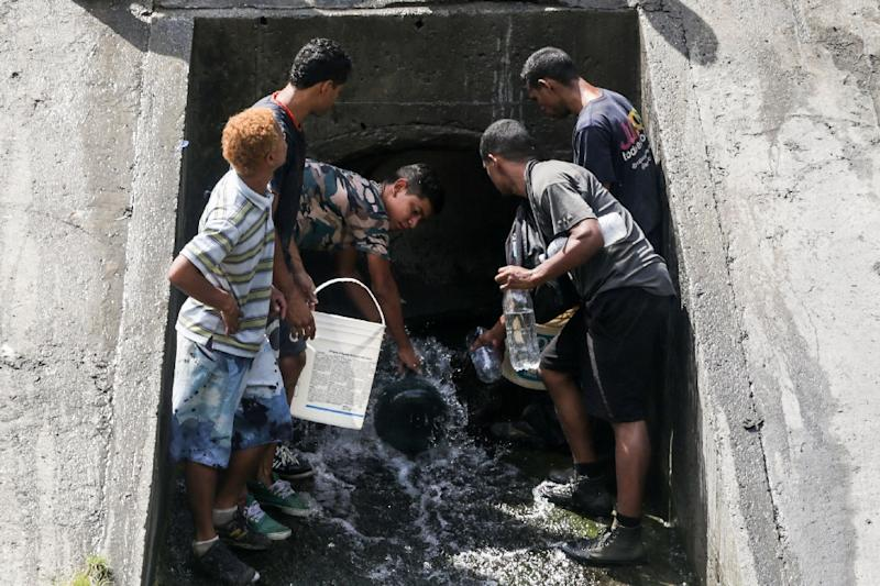 The crisis in Venezuela has led many to seek water in places they would previously not dream of going (AFP Photo/Cristian HERNANDEZ)