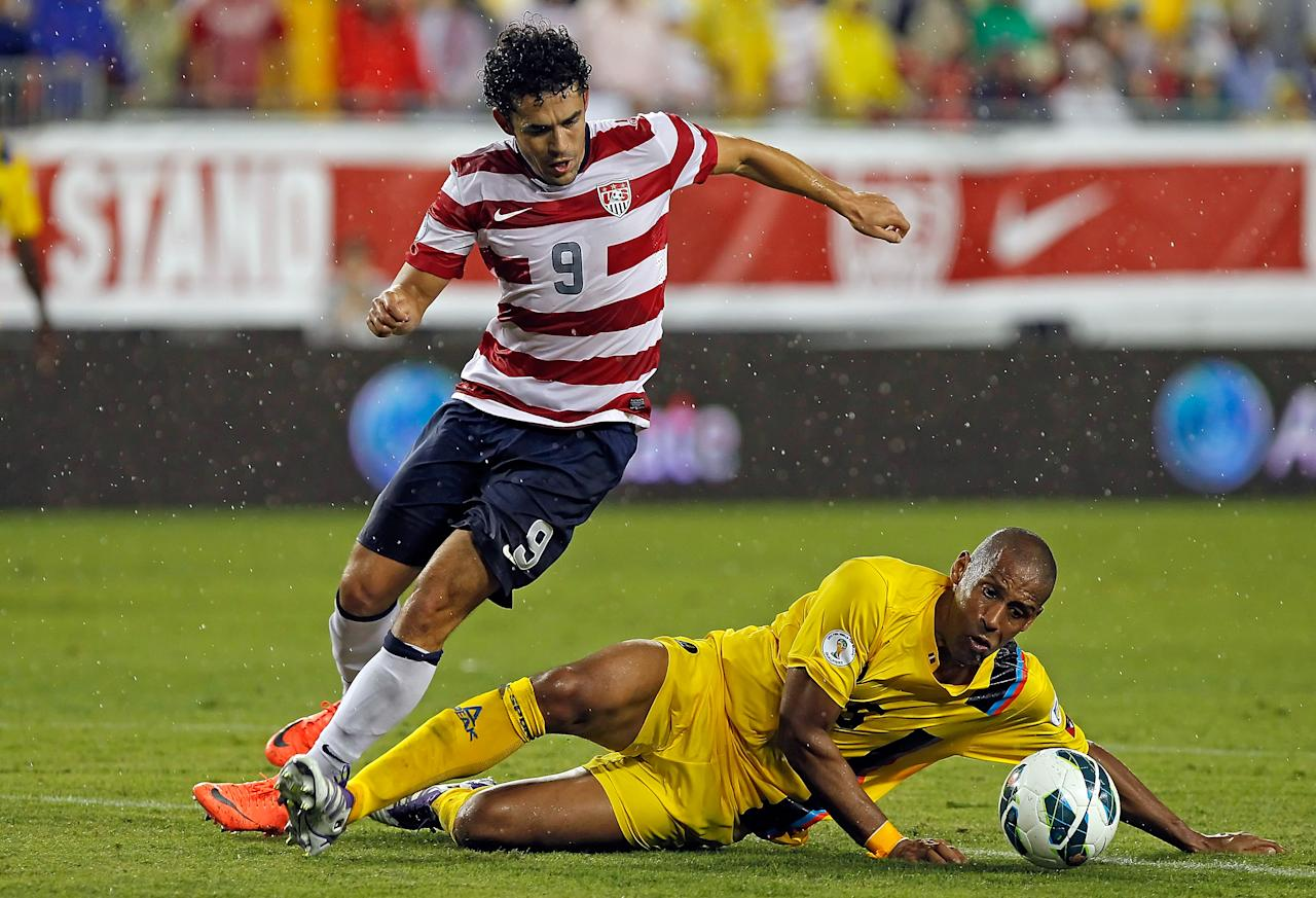 TAMPA, FL - JUNE 08:  Forward Herculez Gomez #9 of Team USA battles defender Marc Joseph #5 of Team Antigua and Barbuda for the ball during the FIFA World Cup Qualifier Match at Raymond James Stadium on June 8, 2012 in Tampa, Florida.  (Photo by J. Meric/Getty Images)