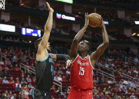 Mar 11, 2019; Houston, TX, USA; Houston Rockets center Clint Capela (15) attempts to shoot the ball over Charlotte Hornets center Willy Hernangomez (41) during the first quarter at Toyota Center. Mandatory Credit: Troy Taormina-USA TODAY Sports