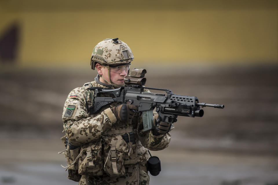 MUNSTER, GERMANY - OCTOBER 13: Soldier with equipment 'Infantryman of the Future - Extended System (IdZ-ES) and ready to fire gun. Shot during an exercise of the land forces on October 13, 2017 in Munster, Germany. (Photo by Florian Gaertner/Photothek via Getty Images)