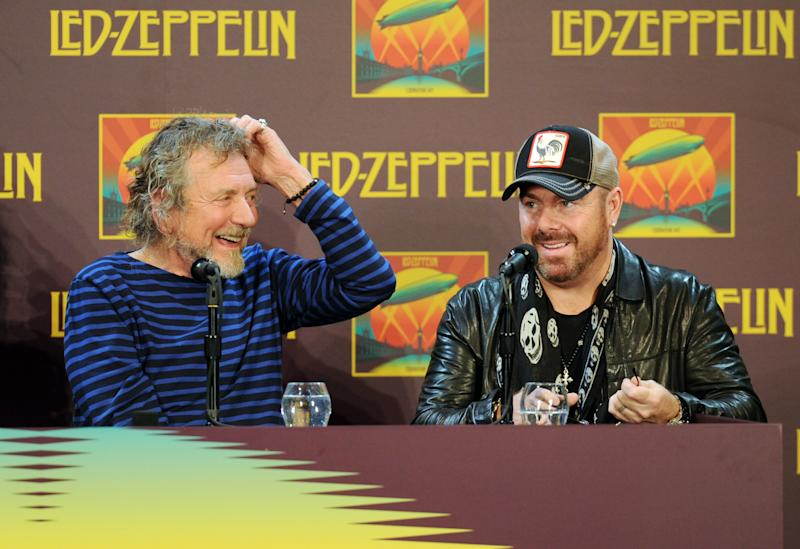 "Led Zeppelin singer Robert Plant, left, and drummer Jason Bonham (son of the late Led Zeppelin original drummer John Bonham) participate in a press conference ahead of the worldwide theatrical release of ""Celebration Day"", a concert film of their 2007 London O2 arena reunion show, at the Museum of Modern Art on Tuesday, Oct. 9, 2012 in New York. (Photo by Evan Agostini/Invision/AP)"