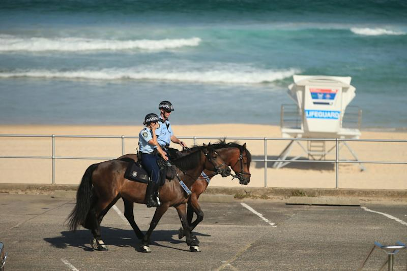 Mounted Police patrol Bondi Beach as all eastern suburbs beaches are closed.