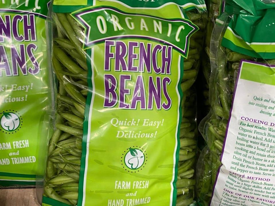 display case of costco bulk organic french beans
