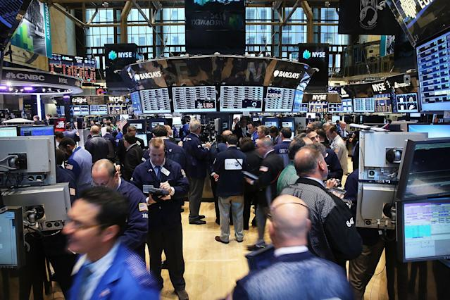 Traders on the floor of the NYSE. (Photo by Spencer Platt/Getty Images)