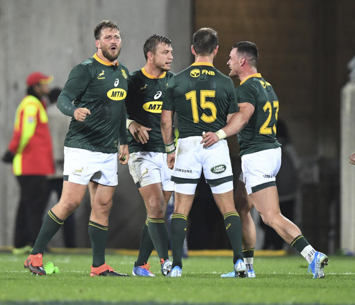 South Africa celebrate their 16 all draw with New Zealand during a Rugby Championship match between the All Blacks and South Africa in Wellington, New Zealand, Saturday, July 27, 2019. (AP Photo/Ross Setford)