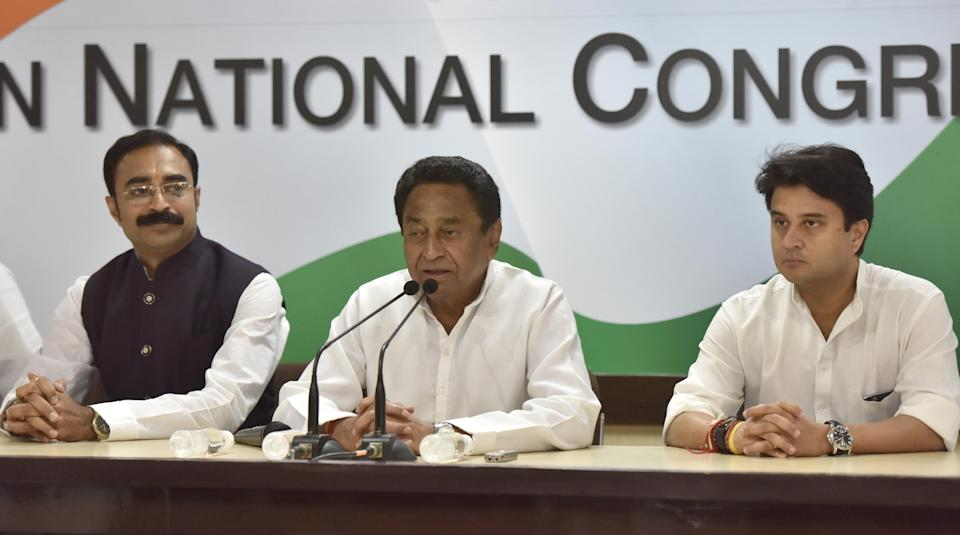 NEW DELHI, INDIA - NOVEMBER 3: Madhya Pradesh Chief Minister Shivraj Singh Chouhans brother-in-law and BJP leader Sanjay Singh Masani (L) addresses media with Congress leaders Kamal Nath (C) and Jyotiraditya Scindia (R) after joining the Congress party, at AICC, on November 3, 2018 in New Delhi, India. Nath said the decision of Masani to join the Congress is a reflection of people's wish to chart a new course of development in Madhya Pradesh. (Photo by Sonu Mehta/Hindustan Times via Getty Images)