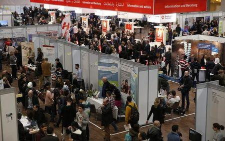 People visit the second job fair for migrants and refugees in Berlin