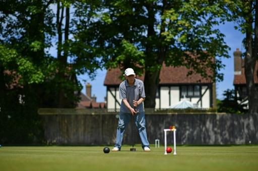 A player in action at Sussex County Croquet Club on England's south coast