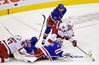 New York Rangers' goaltender Igor Shesterkin (31) stops Carolina Hurricanes' Sebastian Aho (20) as Rangers' Artemi Panarin (10) defends and Hurricanes' Andrei Svechnikov (37) and Rangers' Mika Zibanejad (93) battle during second period NHL Eastern Conference Stanley Cup playoff action in Toronto on Tuesday, Aug. 4, 2020. (Frank Gunn/The Canadian Press via AP)
