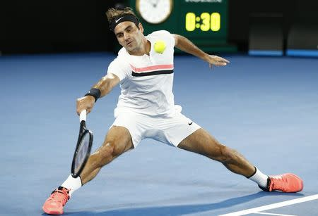 Tennis - Australian Open - Rod Laver Arena, Melbourne, Australia, January 18, 2018. Roger Federer of Switzerland hits a shot against Jan-Lennard Struff of Germany. REUTERS/Thomas Peter