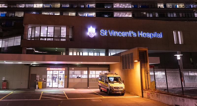 A general view of St Vincent's Hospital in Sydney, with an ambulance parked out the front.