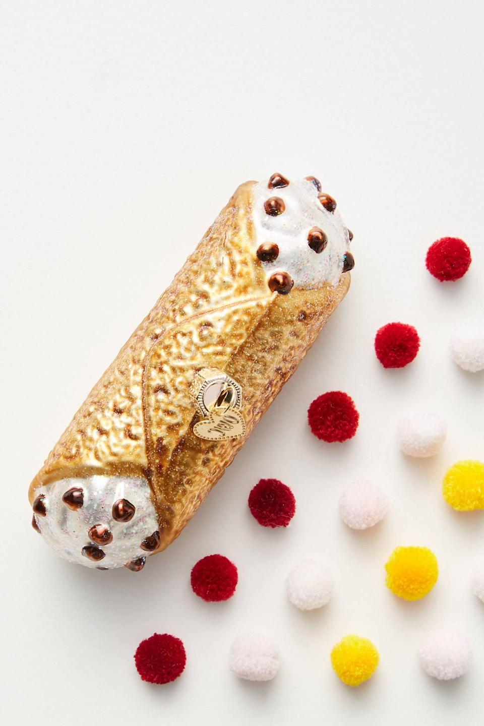 """<p>All we can say is YUM! The <a href=""""https://www.popsugar.com/buy/Cannoli-Ornament-490514?p_name=Cannoli%20Ornament&retailer=anthropologie.com&pid=490514&price=16&evar1=casa%3Aus&evar9=46615300&evar98=https%3A%2F%2Fwww.popsugar.com%2Fhome%2Fphoto-gallery%2F46615300%2Fimage%2F46615384%2FCannoli-Ornament&list1=shopping%2Canthropologie%2Choliday%2Cchristmas%2Cchristmas%20decorations%2Choliday%20decor%2Chome%20shopping&prop13=mobile&pdata=1"""" rel=""""nofollow noopener"""" class=""""link rapid-noclick-resp"""" target=""""_blank"""" data-ylk=""""slk:Cannoli Ornament"""">Cannoli Ornament</a> ($16) is a perfect treat for you and your tree. </p>"""