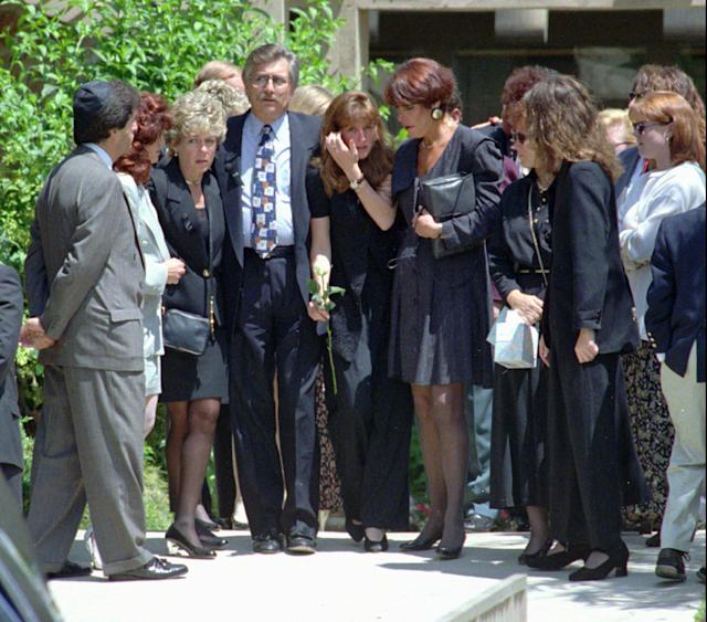<p>That same day, June 16, 1994, Ron Goldman is laid to rest in nearby Westlake Village, Calif., by his father, Fred, left center, his stepmother, Patti, left, and sister Kim, center. (Photo: Kevork Djansezian/AP) </p>