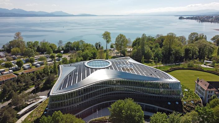 The Olympic rings are pictured on top of the IOC headquarters in Lausanne