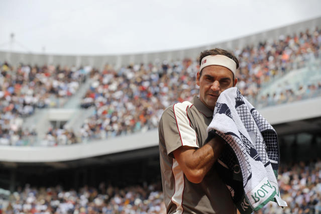 Switzerland's Roger Federer wipes his face during his first round match of the French Open tennis tournament against Italy's Lorenzo Sonego at the Roland Garros stadium in Paris, Sunday, May 26, 2019. (AP Photo/Michel Euler )