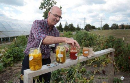 Dr. Brian Halloran. a vascular surgeon at Saint Joseph Mercy Ann Arbor, shows the canned vegetables from his garden across from Saint Joseph Mercy hospital in Ypsilanti, Michigan, U.S., August 23, 2017.  REUTERS/Rebecca Cook