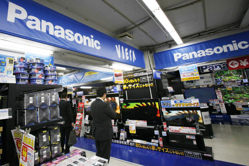 In this Thursday, May 9, 2012 photo,  Shoppers look at Panasonic products at an electronics store in Tokyo. Japanese consumer electronics giant Panasonic Corp. on Friday reported a near-record net loss of 754 billion yen ($7.5 billion) for the fiscal year through March due to restructuring costs and slumping sales, but predicted a return to the black this year as it prunes unprofitable businesses. (AP Photo/Koji Sasahara)