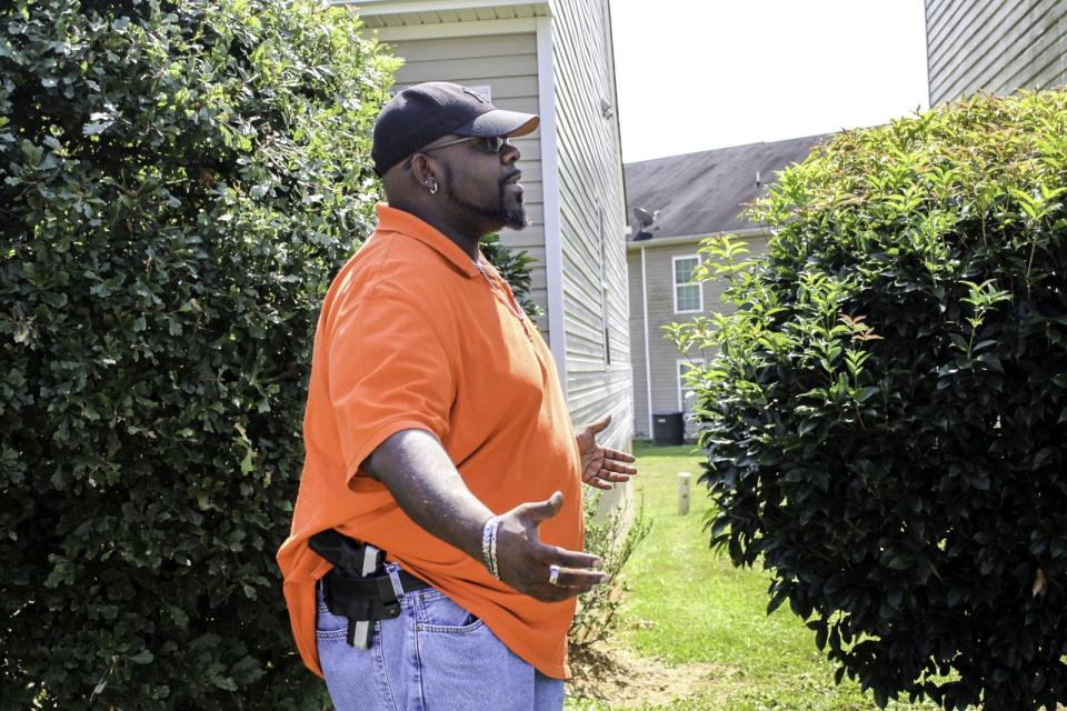 "Luther Thompson, 41, poses with his firearm outside his Cartersville, Ga. home.<span class=""copyright"">Photo courtesy Luther Thompson</span>"