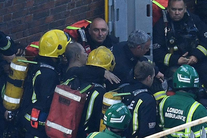 Firefighters were praised at the time of the Grenfell blaze for their bravery (Picture: Getty)