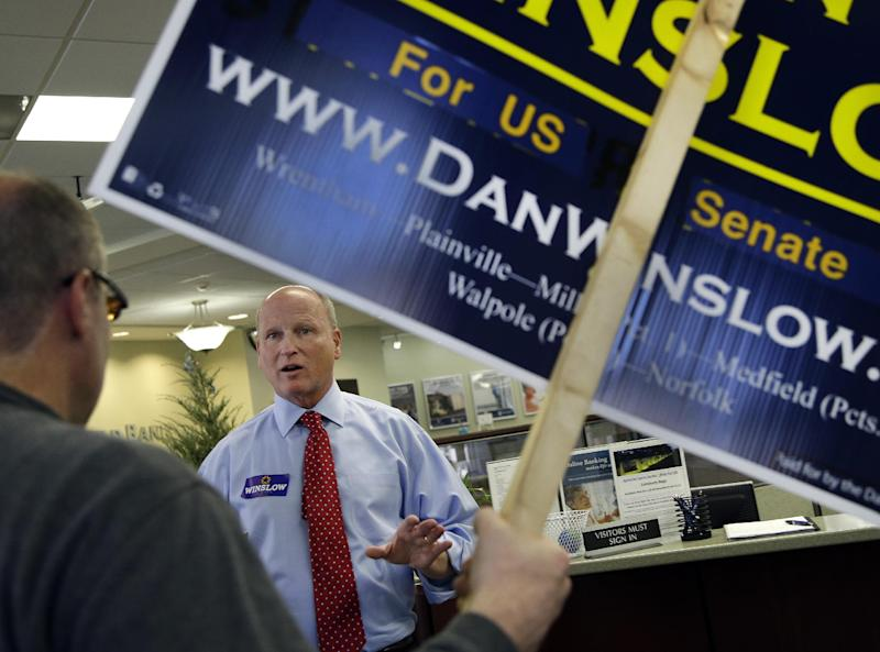 Republican U.S. Senate hopeful Dan Winslow speaks with potential voters in a bank during a tour of downtown Mansfield, Mass. Monday, April 29, 2013. Three Republicans and two Democrats seeking the nominations of their parties to run in a special U.S. Senate election are making a final pre-primary push for votes. A light turnout is expected for Tuesday's primary. (AP Photo/Elise Amendola)