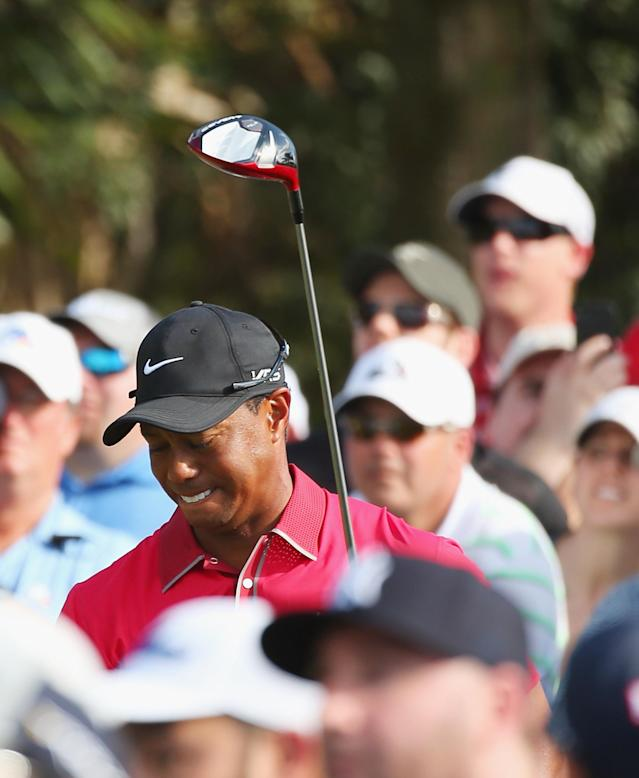 DORAL, FL - MARCH 09: Tiger Woods reacts to his tee shot on the 12th hole during the final round of the World Golf Championships-Cadillac Championship at Trump National Doral on March 9, 2014 in Doral, Florida. (Photo by Mike Ehrmann/Getty Images)