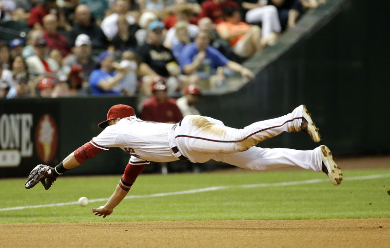 Arizona Diamondbacks' Martin Prado can't stop a ball that went for a base hit by Los Angeles Dodgers' Dee Gordan during the fourth inning of a baseball game on Friday, May 16, 2014, in Phoenix. (AP Photo/Matt York)