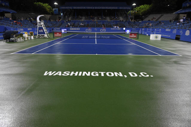 The stadium court lies wet and matchless during a weather delay at the Citi Open tennis tournament, Friday, Aug. 3, 2018, in Washington. (AP Photo/Nick Wass)
