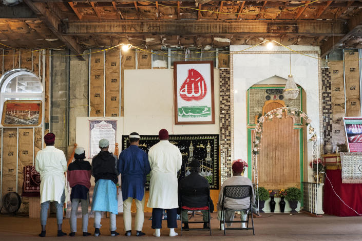 FILE - In this Sept. 7, 2017 file photo, men pray at the mosque at Islamberg in Delaware County, N.Y. The enclave just west of the Catskill Mountains is dogged by terror accusations, many spread on right-wing websites. (AP Photo/Mark Lennihan)