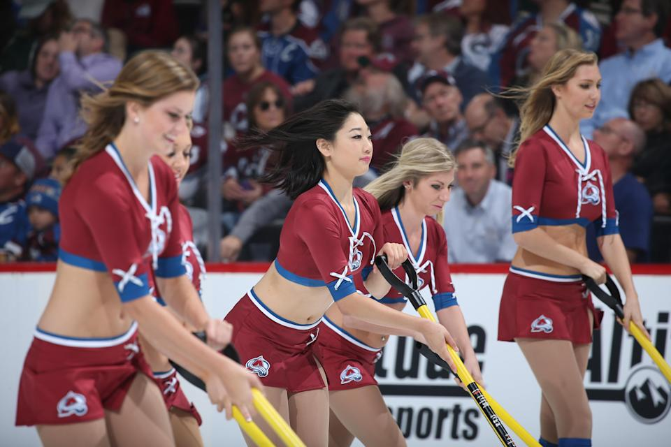 <p>Members of the Colorado Avalanche ice girls clear the ice against the Minnesota Wild at the Pepsi Center on October 8, 2015 in Denver, Colorado. (Photo by Michael Martin/NHLI via Getty Images) </p>