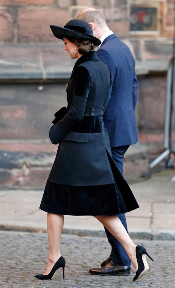 <p>For a memorial service for the sixth Duke of Westminster, Duchess Catherine wears a black wool Alexander McQueen ensemble trimmed with black velvet.</p>