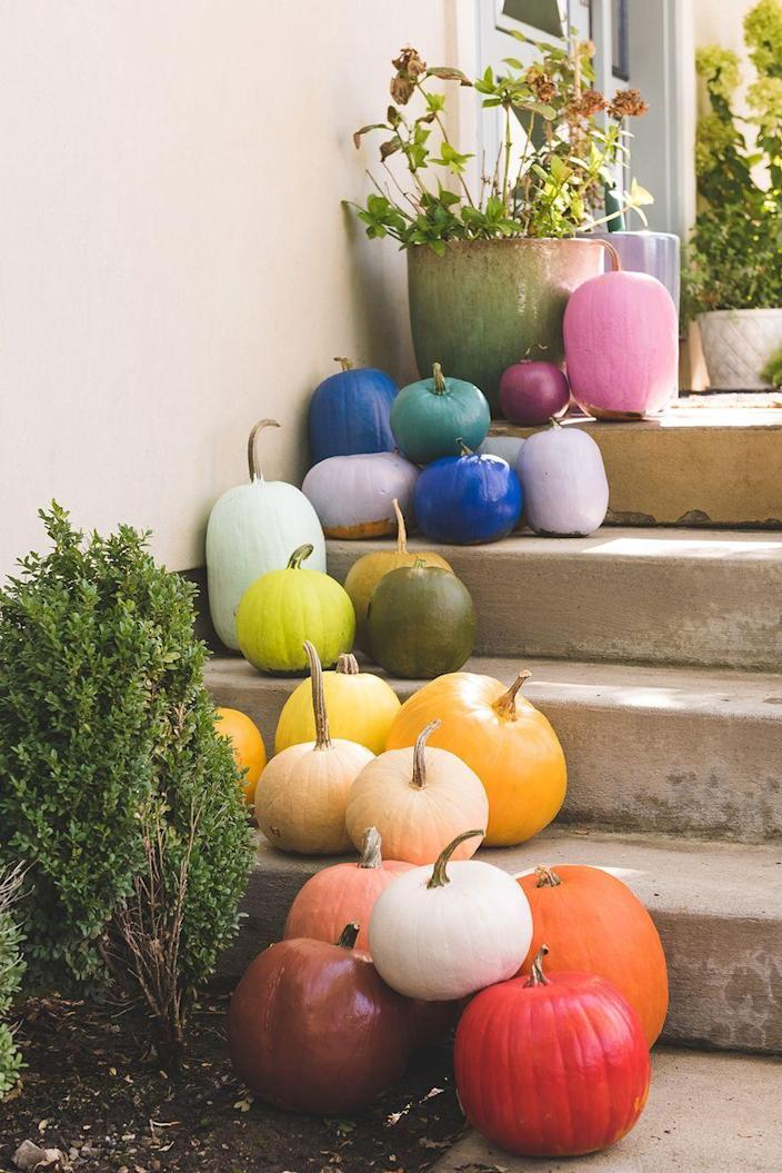 """<p>Not only are these painted pumpkins fun to look at (okay, fine, <em>stare</em> at), but they're also a great fall activity for the little ones. Win-win!</p><p><strong>Get the tutorial at <a href=""""https://thehousethatlarsbuilt.com/2018/10/diy-rainbow-pumpkins.html/"""" rel=""""nofollow noopener"""" target=""""_blank"""" data-ylk=""""slk:The House That Lars Built"""" class=""""link rapid-noclick-resp"""">The House That Lars Built</a>.</strong></p><p><strong><a class=""""link rapid-noclick-resp"""" href=""""https://go.redirectingat.com?id=74968X1596630&url=https%3A%2F%2Fwww.walmart.com%2Fsearch%2F%3Fquery%3Dcraft%2Bpaint&sref=https%3A%2F%2Fwww.thepioneerwoman.com%2Fhome-lifestyle%2Fdecorating-ideas%2Fg36732301%2Foutdoor-fall-decorations%2F"""" rel=""""nofollow noopener"""" target=""""_blank"""" data-ylk=""""slk:SHOP FAUX PUMPKINS"""">SHOP FAUX PUMPKINS</a></strong></p>"""