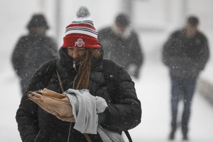 Commuters brave the wind and snow in frigid weather on Jan. 30, 2019, in Cincinnati. The extreme cold and record-breaking temperatures are affecting a swath of states spanning from North Dakota to Missouri and into Ohio after a powerful snowstorm pounded the region earlier this week. (Photo: John Minchillo/AP)