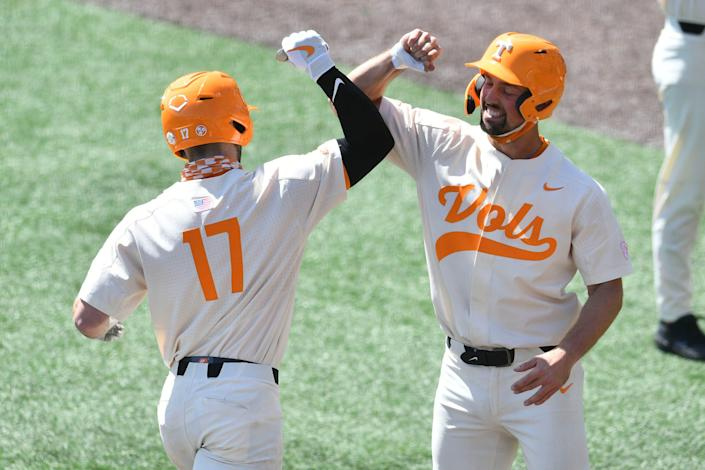 Tennessee's Connor Pavolony (17) is congratulated by Luc Lipcius (40) after Pavlony hit a 2-run homer during against Florida on April 11.
