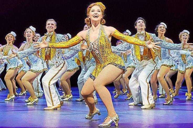 Turning on the tap: Clare Halse as Peggy Sawyer leads the chorus in one of the musical's many dance numbers