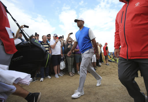 Tiger Woods of the US walks to the 5th tee box during the first round of the British Open Golf Championship in Carnoustie, Scotland, Thursday July 19, 2018. (AP Photo/Jon Super)