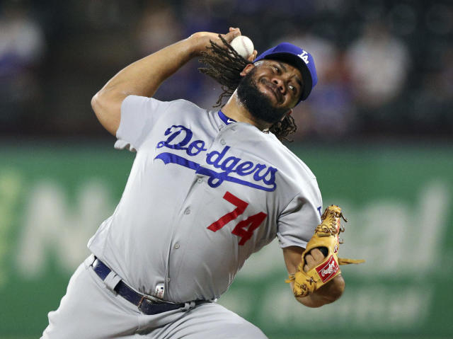 Los Angeles Dodgers relief pitcher Kenley Jansen (74) delivers a pitch in the ninth inning a baseball game against the Texas Rangers, Tuesday, Aug. 28, 2018, in Arlington, Texas. (AP Photo/Richard W. Rodriguez)