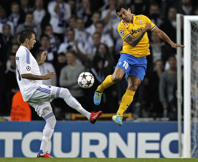Juventus striker Carlos Tevez of Argentina, right, and FC Copenhagen's Claudemir de Souza of Brazil compete for the ball during their Champions League Group B soccer match at the Parken Stadium, Copenhagen, Denmark, Tuesday Sep. 17, 2013. (AP Photo/Polfoto/Jens Dresling)