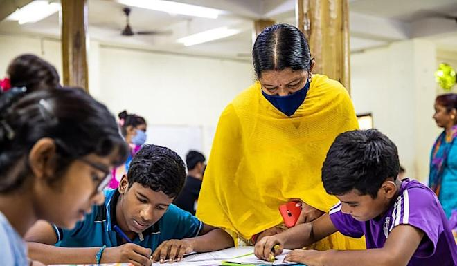 Students work on an assignment at the Good Shepherd Agricultural Mission, a school and orphanage India. Photo: Handout