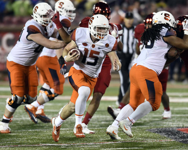 FILE - In this Nov. 18, 2017, file photo, Syracuse Orange quarterback Rex Culpepper (15) runs against the University of Louisville in Louisville, Ky. Culpepper was diagnosed with testicular cancer after spring break and underwent 100 hours of chemotherapy. In early June 2018, doctors at Moffitt Cancer Center in Tampa, Fla. told him he was cancer free. (AP Photo/Timothy D. Easley, File)