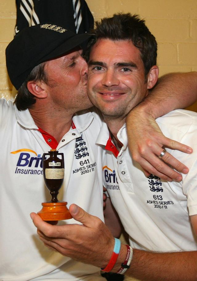 England cricketer Graeme Swann (L) kisses England cricketer James Anderson as he holds a replica of the Ashes urn, in the dressing room after winning the series 3-1 during day five of the Fifth Ashes Test match between Australia and England, at Sydney Cricket Ground, in Sydney, Australia, on January 7, 2011. AFP PHOTO/TOM SHAW/POOL IMAGE STRICTLY RESTRICTED TO EDITORIAL USE - STRICTLY NO COMMERCIAL USE (Photo credit should read TOM SHAW/AFP/Getty Images)