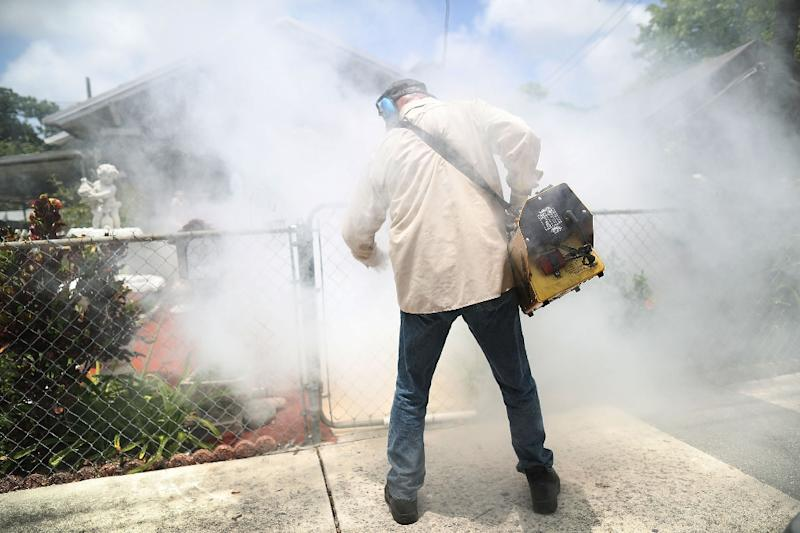 A mosquito control inspector sprays pesticide to kill mosquitos as part of the US fight to control the Zika virus outbreak in Miami, Florida in August 2016