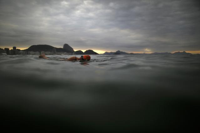 A Local resident swims at Copacabana Beach in Rio de Janeiro, Brazil, a day before the opening ceremony of the Rio 2016 Olympic Games, August 4, 2016. Picture taken August 4, 2016. REUTERS/Carlos Barria