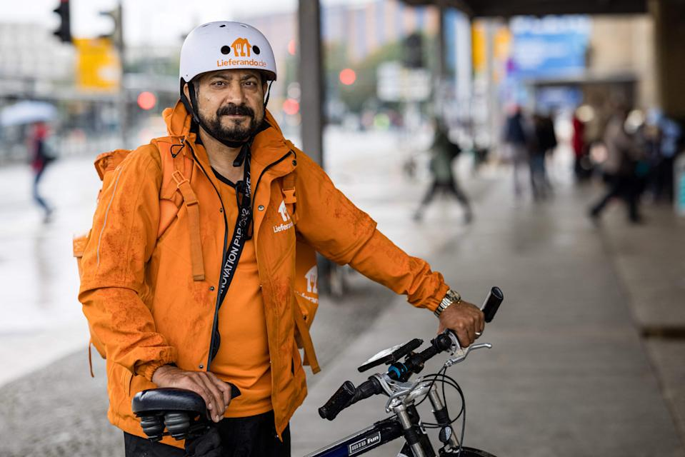 Sayed Sadaat, former communications minister in Afghanistan, poses for a photo in Leipzig, eastern Germany on August 29, 2021. - Sadaat, minister in Afghanistan from 2016 to 2018, quit, fed up with the corruption. Now in Germany, he is making a living delivering meals as a bicycle courier. - TO GO WITH AFP STORY by Hui Min NEO (Photo by JENS SCHLUETER / AFP) / TO GO WITH AFP STORY by Hui Min NEO (Photo by JENS SCHLUETER/AFP via Getty Images)