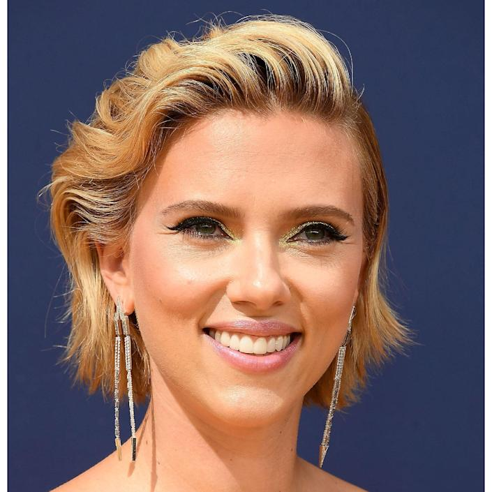 """What we love about Scarlett Johanssen's blonde is how maintainable it happens to be. So your roots are a little dark? Join the club. Because this dye job is purposefully chunky and imperfect, she never has to worry about grow-out. """"This blonde is so effortless while reflecting so much shine,"""" says <a href=""""https://www.instagram.com/karissakolorist/?hl=en"""" rel=""""nofollow noopener"""" target=""""_blank"""" data-ylk=""""slk:Karissa Schaudt"""" class=""""link rapid-noclick-resp"""">Karissa Schaudt</a>, colorist at <a href=""""https://maxinesalon.com/"""" rel=""""nofollow noopener"""" target=""""_blank"""" data-ylk=""""slk:Maxine Salon"""" class=""""link rapid-noclick-resp"""">Maxine Salon</a> in Chicago. """"It looks like it was lightened and left untoned, leaving the look natural with warm golden undertones. The warm tones reflect the most shine making it appear super healthy."""""""