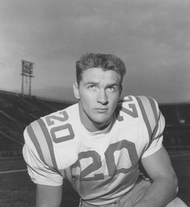 File-This 1958 file photo shows Billy Cannon (20), Louisiana State University halfback. Cannon, the gifted running back who won the Heisman Trophy for LSU in 1959 with a memorable Halloween night punt return touchdown against Mississippi, died Sunday, May 20, 2018. He was 80. LSU said Cannon, the schools only Heisman winner, died at his home in St. Francisville, La. The cause of death was not immediately known. (AP Photo/File)